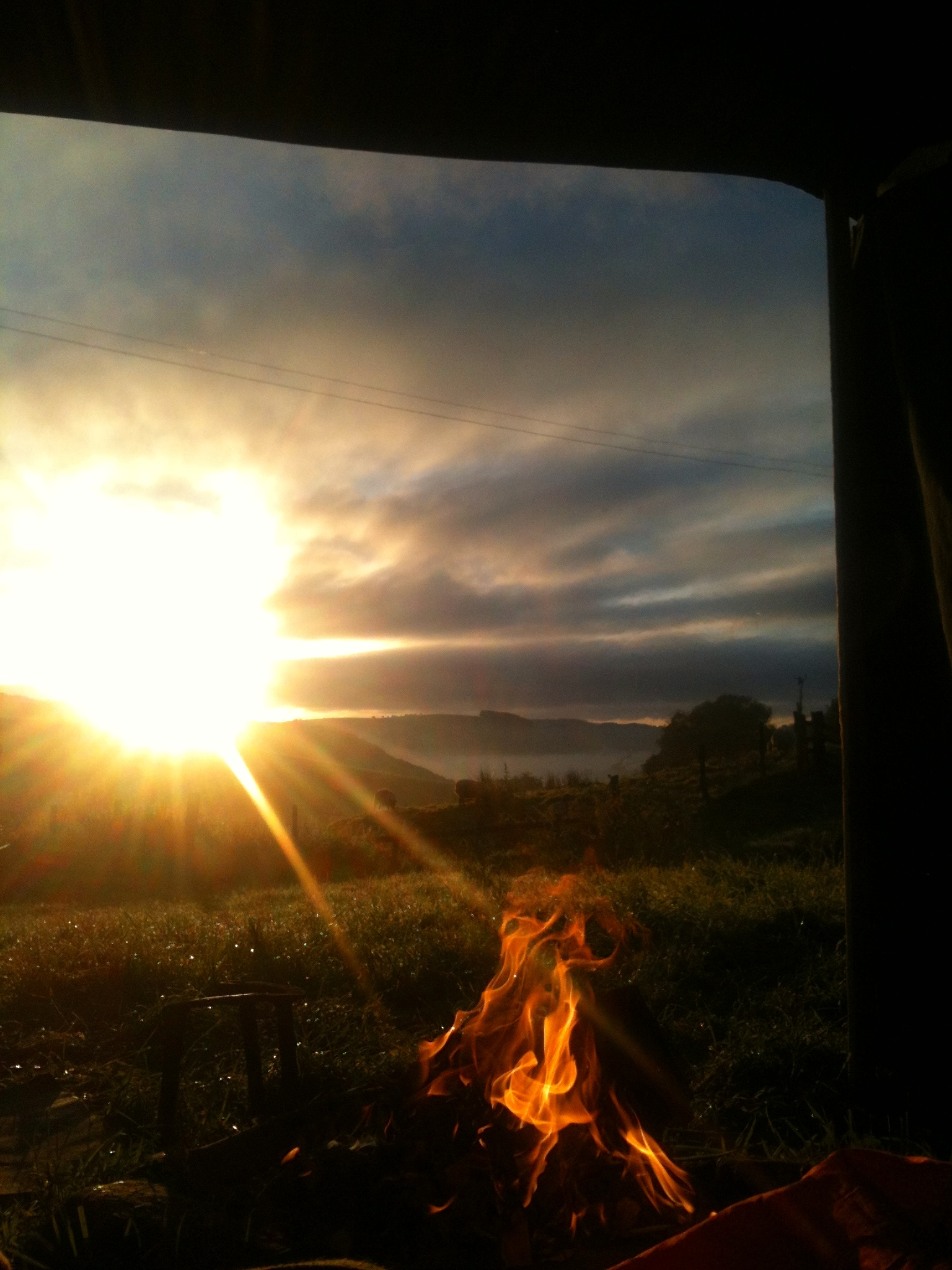 Sunrise and fire from the tent
