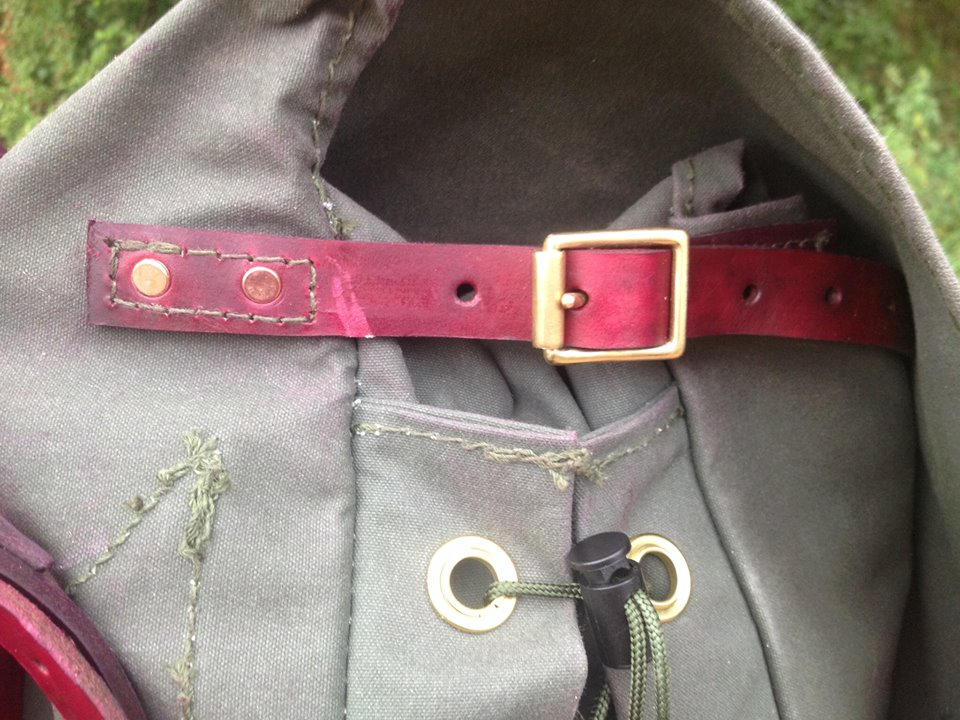 Side closing strap with brass buckle